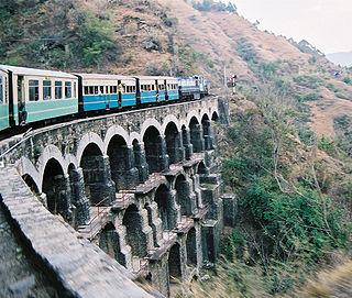 https://upload.wikimedia.org/wikipedia/commons/thumb/d/d8/KSR_Train_on_a_big_bridge_05-02-12_71.jpeg/320px-KSR_Train_on_a_big_bridge_05-02-12_71.jpeg